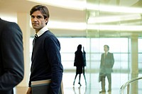 Businessman in lobby, portrait (thumbnail)