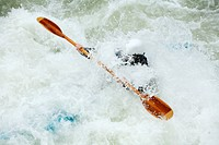 Whitewater kayaker swalled by foam.