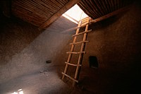 Ladder descends into anasazi kiva, Bandelier National Monument, New Mexico, USA