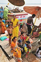 Pilgrims at the ghat by the Ganges river