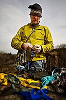 A man packs climbing gear at Palisades State Park, South Dakota.