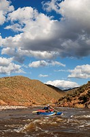 A whitewater rafters rows his boat downstream on the Salt River, AZ.