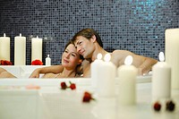Italy, SouthTyrol, Couple having romantic bath in hotel urthaler