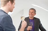 Germany, Bavaria, Men drinking wine, smiling