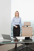 Germany, Frankfurt, Business woman in office, smiling, portrait