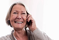 Germany, Wakendorf, Senior woman on the phone, smiling