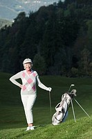 Italy, Kastelruth, Mature woman with golf bag on golf course