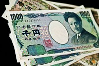 Japanese currency _ 1,000 and 10,000 yen banknotes.