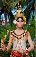 Cambodia, Siem Reap, Young woman wearing traditional dancer attire.
