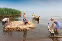 People on Reed Boat and Reed Mat, Lake Peipsi, Estonia, Europe