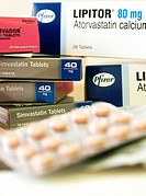 Boxes and blister packs of assorted statin drugs. Statins blocks the production of cholesterol in the body and lower levels of low_density lipoprotein...