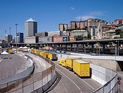 trucks by the harbor and skyline of the city - Genoa - Italy