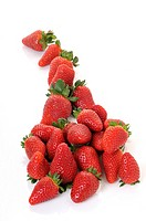 pile of strawberries on white background