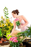 Gardening _ smiling woman holding flower pot