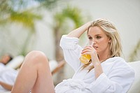 Woman relaxing in a spa on deckchair