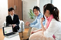 Businessman talking to a couple, Tokyo Prefecture, Honshu, Japan