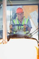Building worker driving a fork truck