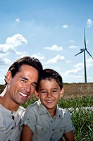 Father and son portrait on a wind farm