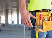 Close up of construction worker&#8217;s tool belt on construction site
