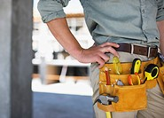 Close up of construction worker's tool belt on construction site