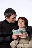 married couple counting a bunch of euro banknotes