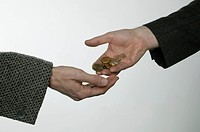 person receiving a heap of coins from a banker