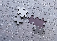 two missing jigsaw pieces on a white puzzle