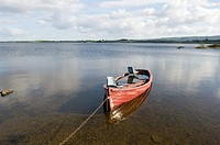 Republic of Ireland, Connemara, Lough Corrib, boat moored on lake