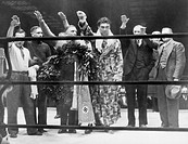 Max Schmeling, with attendants, giving the Nazi salute after his victory over Steve Hamas in Hamburg, Germany, March 10, 1935