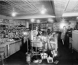 1920's showroom of Schneider Electric Store in Washington, D.C. Among the electric consumer products on display include: lamps, fans, space heaters, f...