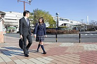 Father and High School Girl Walking