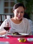 Hispanic woman having dinner in restaurant