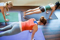 Three woman doing yoga class