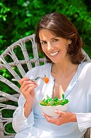 Woman with a bowl of salad