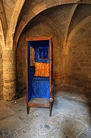 A 16th century sedan chair at the historic Hotel Lacoste in Pezenas, France