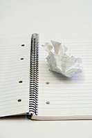 crumpled paper on paper notebook