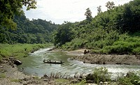 The local boatmen of Boropatharia driving their boat in Sankha River at Bandarban Hill Tracts Bangladesh Oct 2005