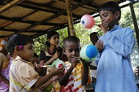 Some village boys are playing with baloons at Bagura, Bangladesh July 14, 2007