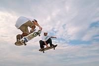 Skateboarders in mid_air