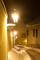 Prague _ narrow street at hradcany with gas lanterns in winter