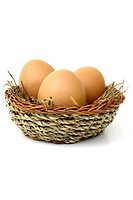 Three eggs in a nest woven