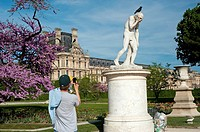 Paris, France, People Enjoying Warm Weather on Lawn in Tuileries Garden, Jardin des Tuileries, Near Louvre Museum