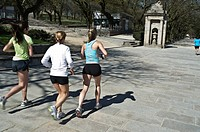 Three girls running in a park of Santiago de Compostela. Galicia, Spain