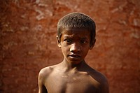Portrait of a child worker who works at a brickfield Dhaka, Bangladesh February 2011