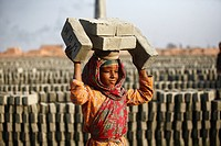 Girl child worker carrying bricks on her head at Fatullah Narayanganj, Bangladesh February 2011