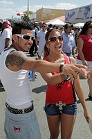 Florida, Miami, Little Havana, Calle Ocho Street Festival, Hispanic, annual event, celebration, man, woman, couple, fashionable, young adults,