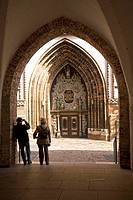 Tourists appreciate the ornate Baroque style door on the Nikolaikirche St. Nicholas´ Church in Stralsund, Mecklenburg_Vorpommern, Germany, Europe