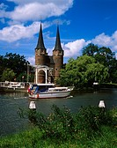 Boat on the canal passing the Eastern Gate Oostpoort, Last of the ancient gateways into the city of Delft