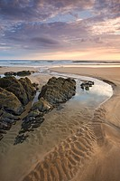 Rockpools on sandy Coombesgate Beach at low tide, Woolacombe, Devon, England, United Kingdom, Europe