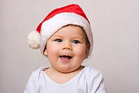 Smiling baby boy, 8 months, dressed as Santa Claus